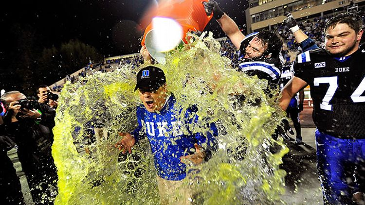 Duke and David Cutcliffe celebrate after beating Miami