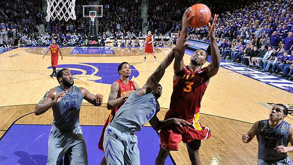Forward Melvin Ejim #3 of the Iowa State Cyclones goes up for a rebound against forward Thomas Gipson #42 of the Kansas State Wildcats during the second half on February 9, 2013 at Bramlage Coliseum in Manhattan, Kansas.