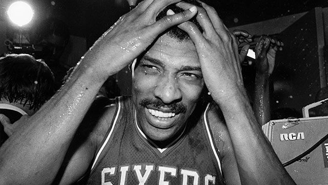 Julius Erving of the Philadelphia 76ers celebrates following Game Four of the NBA Finals played against the Los Angeles Lakers on May 31, 1983 at the Great Western Forum in Los Angeles, California. Philadelphia defeated Los Angeles 115-108 and won the ser