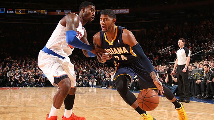 Paul George #24 of the Indiana Pacers drives against Iman Shumpert #21 of the New York Knicks during a game at Madison Square Garden in New York City on November 20, 2013.
