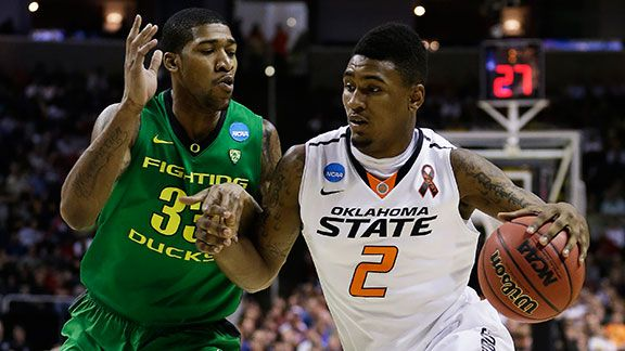 Le'Bryan Nash #2 of the Oklahoma State Cowboys drives against Carlos Emory #33 of the Oregon Ducks in the first half during the second round of the 2013 NCAA Men's Basketball Tournament at HP Pavilion on March 21, 2013 in San Jose, California.