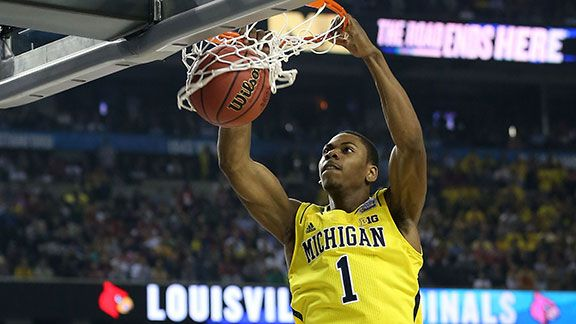 Glenn Robinson III #1 of the Michigan Wolverines dunks in the first half against the Louisville Cardinals during the 2013 NCAA Men's Final Four Championship at the Georgia Dome on April 8, 2013 in Atlanta, Georgia.
