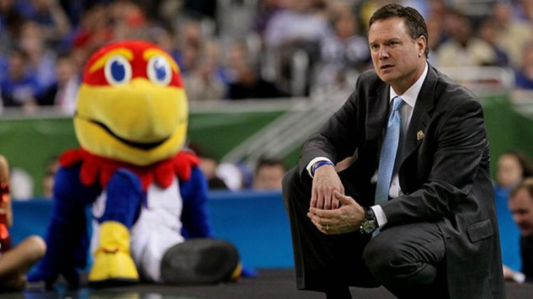 Head coach Bill Self of the Kansas Jayhawks reacts in the first half as the Jayhawks mascot looks over at him as the Jayhawks take on the Ohio State Buckeyes during the National Semifinal game of the 2012 NCAA Division I Men's Basketball Championship at t