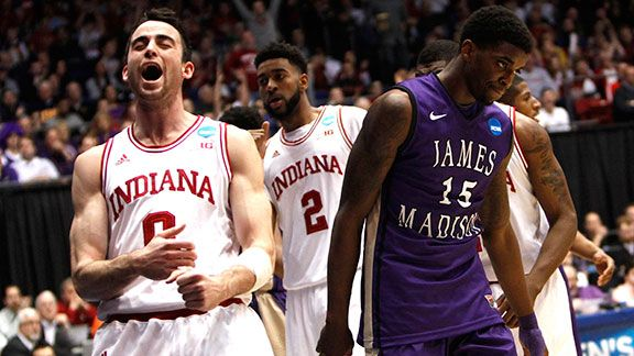 Indiana's Will Sheehey (0) reacts in front of James Madison's Andre Nation (15) after scoring a basket during the first half in the second round of the NCAA Tournament at the University of Dayton Arena in Dayton, Ohio, on Friday, March 22, 2013.