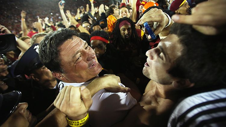 USC's Ed Orgeron celebrates his team's upset win over Stanford