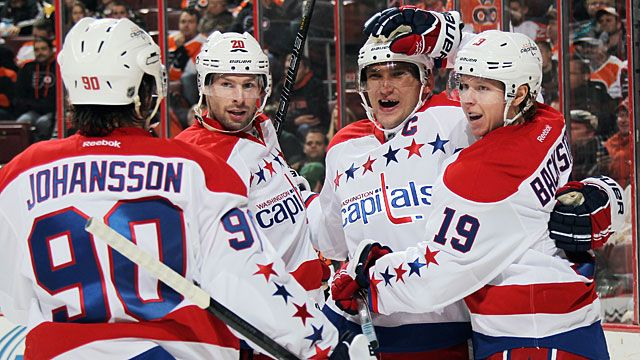Marcus Johansson #90, Troy Brouwer #20, Alex Ovechkin #8, and Nicklas Backstrom #19 of the Washington Capitals