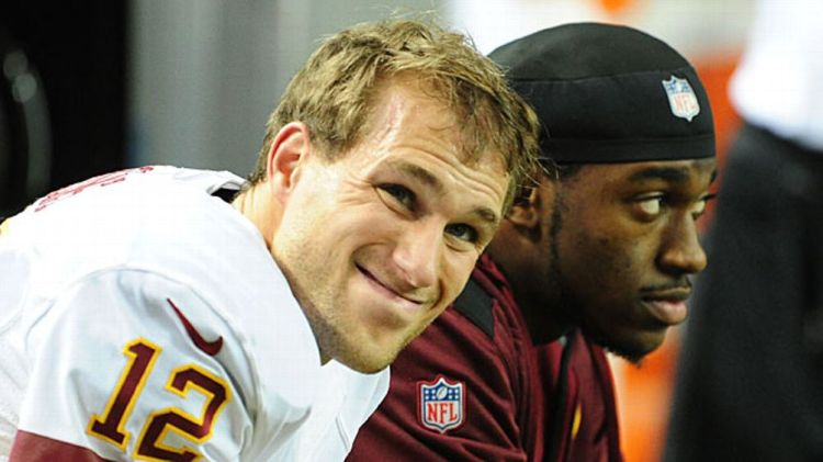 Kirk Cousins #12 of the Washington Redskins chats with Robert Griffin III