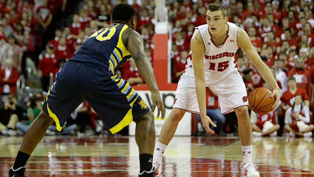 Sam Dekker #15 of the Wisconsin Badgers dribbles the basketball during the second half against the Marquette Golden Eagles at Kohl Center on December 07, 2013 in Madison, Wisconsin.