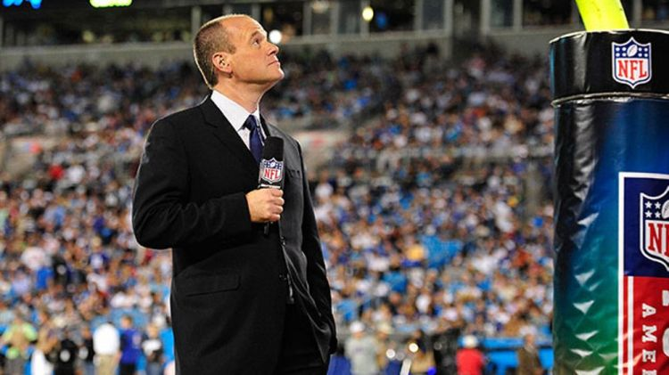 Rich Eisen of the NFL Network reports from the sidelines of the game between the New York Giants and the Carolina Panthers during play at Bank of America Stadium on September 20, 2012 in Charlotte, North Carolina. The Giants won 36-7.