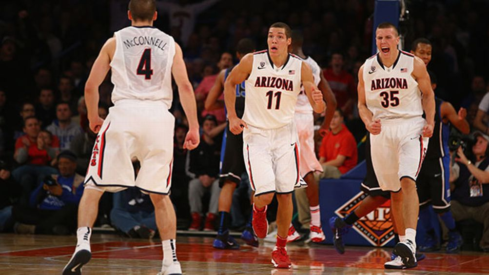 Kaleb Tarczewski #35 of the Arizona Wildcats celebrates a dunk with Aaron Gordon #11, and T.J. McConnell #4 during their championship game of the NIT Season Tip Off against Duke Blue Devils at Madison Square Garden on November 29, 2013 in New York City.