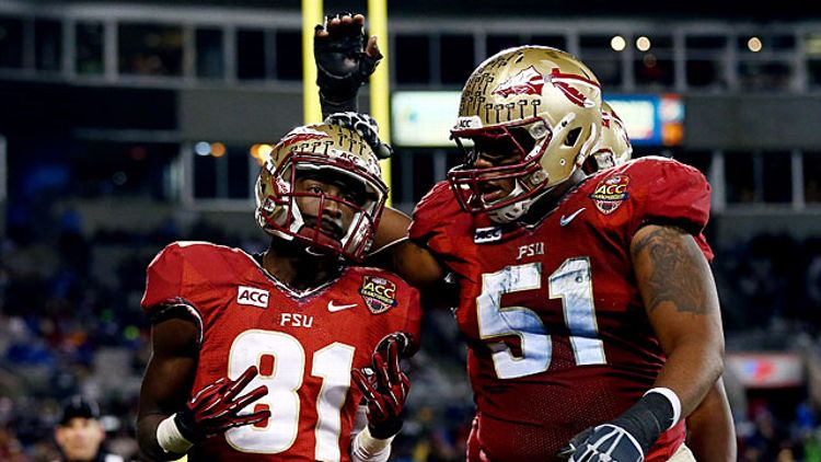 Wide receiver Kenny Shaw #81 celebrates a touchdown with offensive lineman Bobby Hart #51
