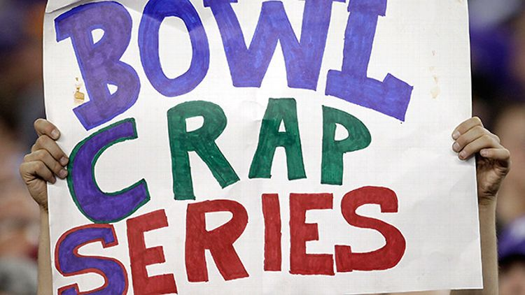 A fan holds up a 'Bowl Crap Series' sign to mock the BCS