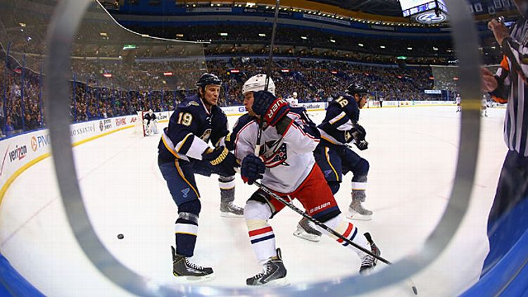 Jay Bouwmeester #19 of the St. Louis Blues keeps Brandon Dubinsky #17 of the Columbus Blue Jackets