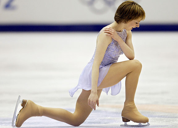 US Sarah Hughes performs kneels on the ice during