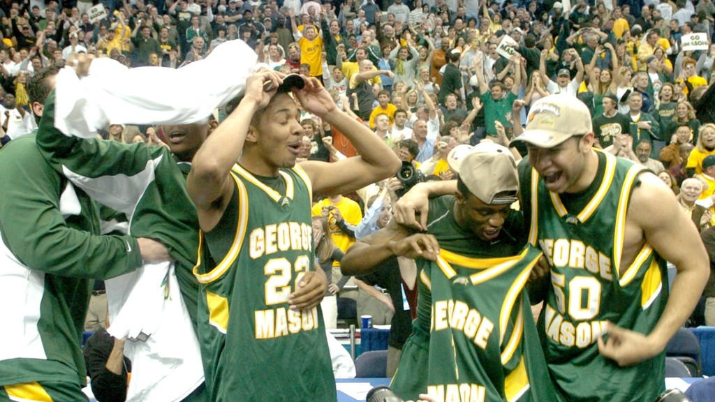 George Mason celebrates after defeating Connecticut 86-84 du