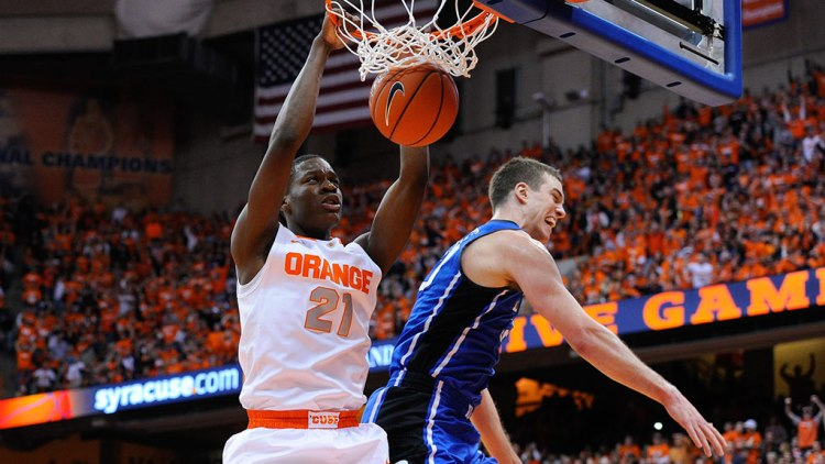 Tyler Roberson #21 of the Syracuse Orange dunks the ball against Marshall Plumlee #40 of the Duke Blue Devils during the first half at the Carrier Dome on February 1, 2014 in Syracuse, New York.