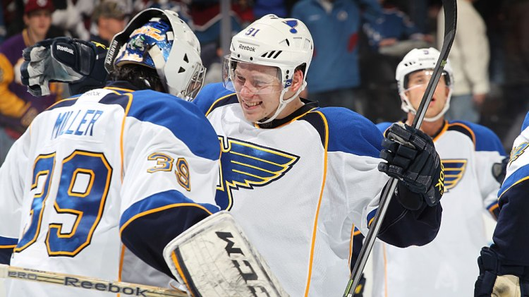 Vladimir Tarasenko #91 and Ryan Miller #39 of the St Louis Blues