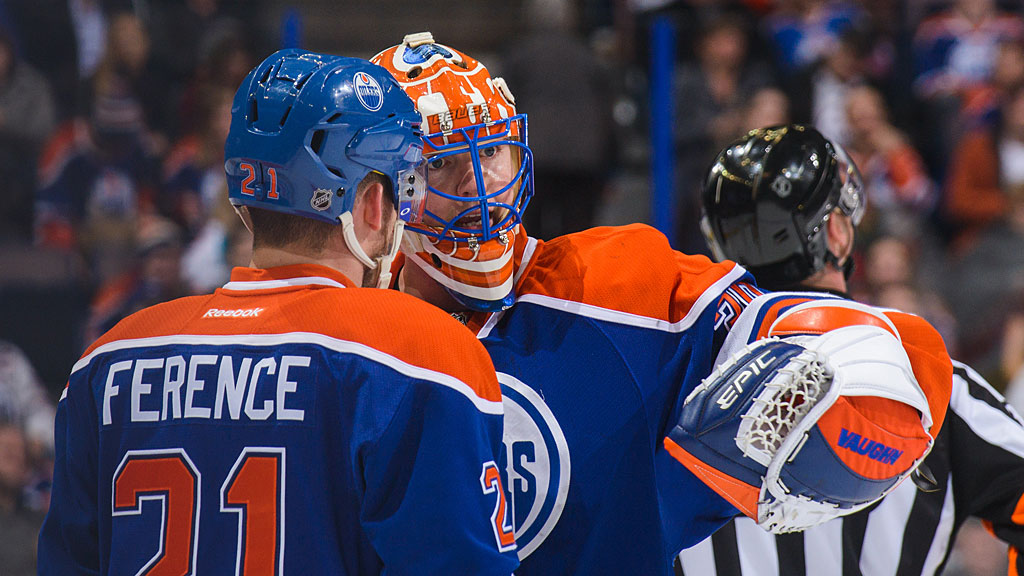 Andrew Ference #21 (L) and Ben Scrivens #30 of the Edmonton Oilers