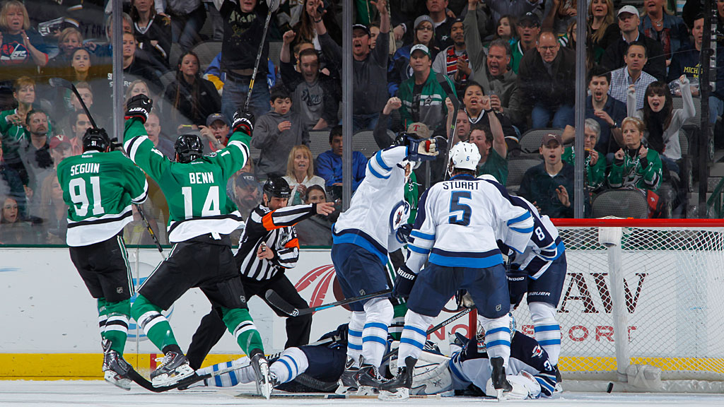 Jamie Benn #14 and Tyler Seguin #91 of the Dallas Stars celebrate a goal against the Winnipeg Jets