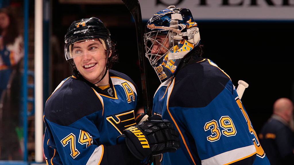T.J. Oshie #74 of the St. Louis Blues celebrates with goalie Ryan Miller