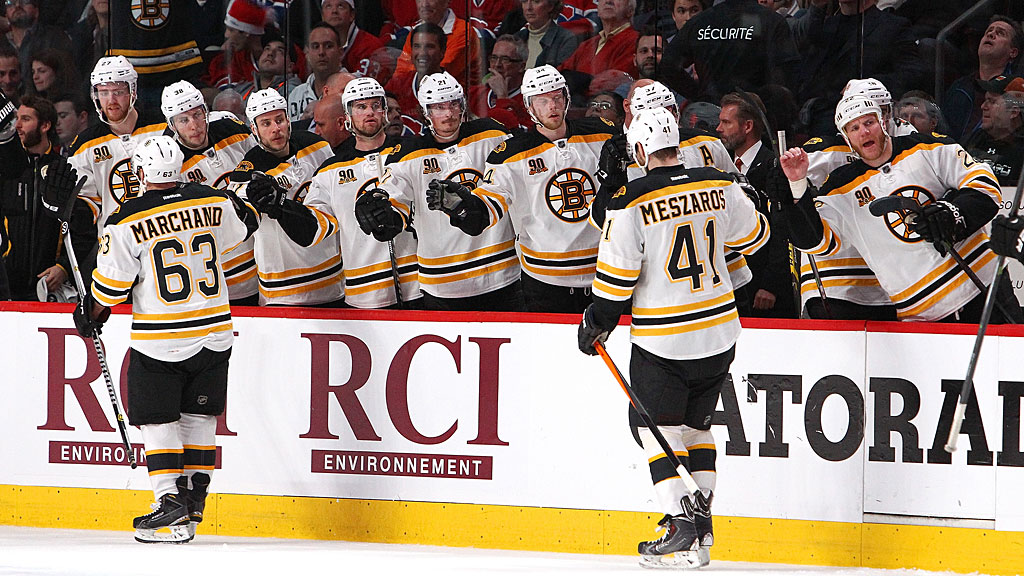 Andrej Meszaros #41 and Brad Marchand #63 of the Boston Bruins