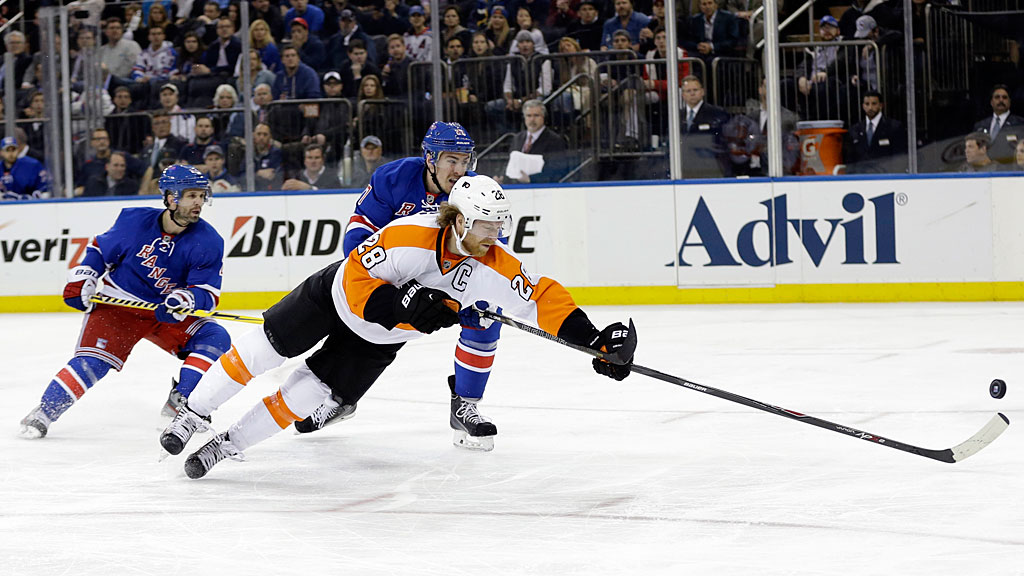 Philadelphia Flyers' Claude Giroux (28) dives past New York Rangers' Martin St. Louis (26)