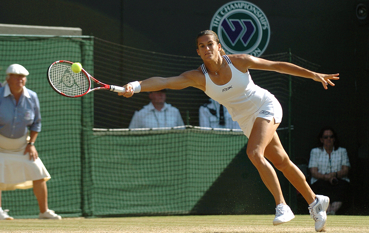 Amelie Mauresmo of France returns the ba