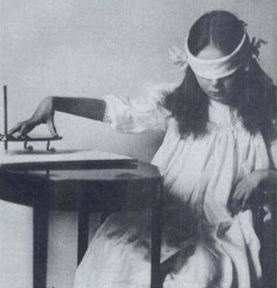 girl-using-ouija-board