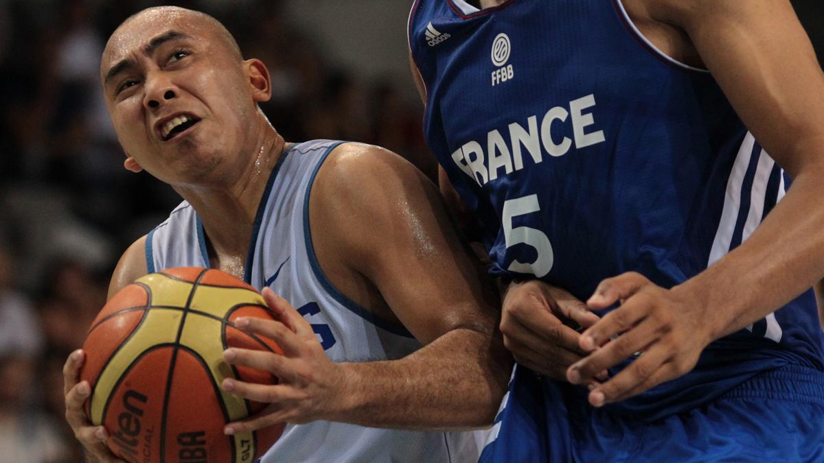 Paul Lee drives against France.