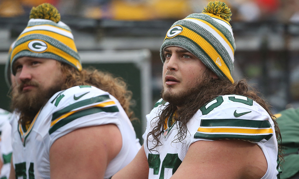 Left tackle David Bakhtiari (foreground)