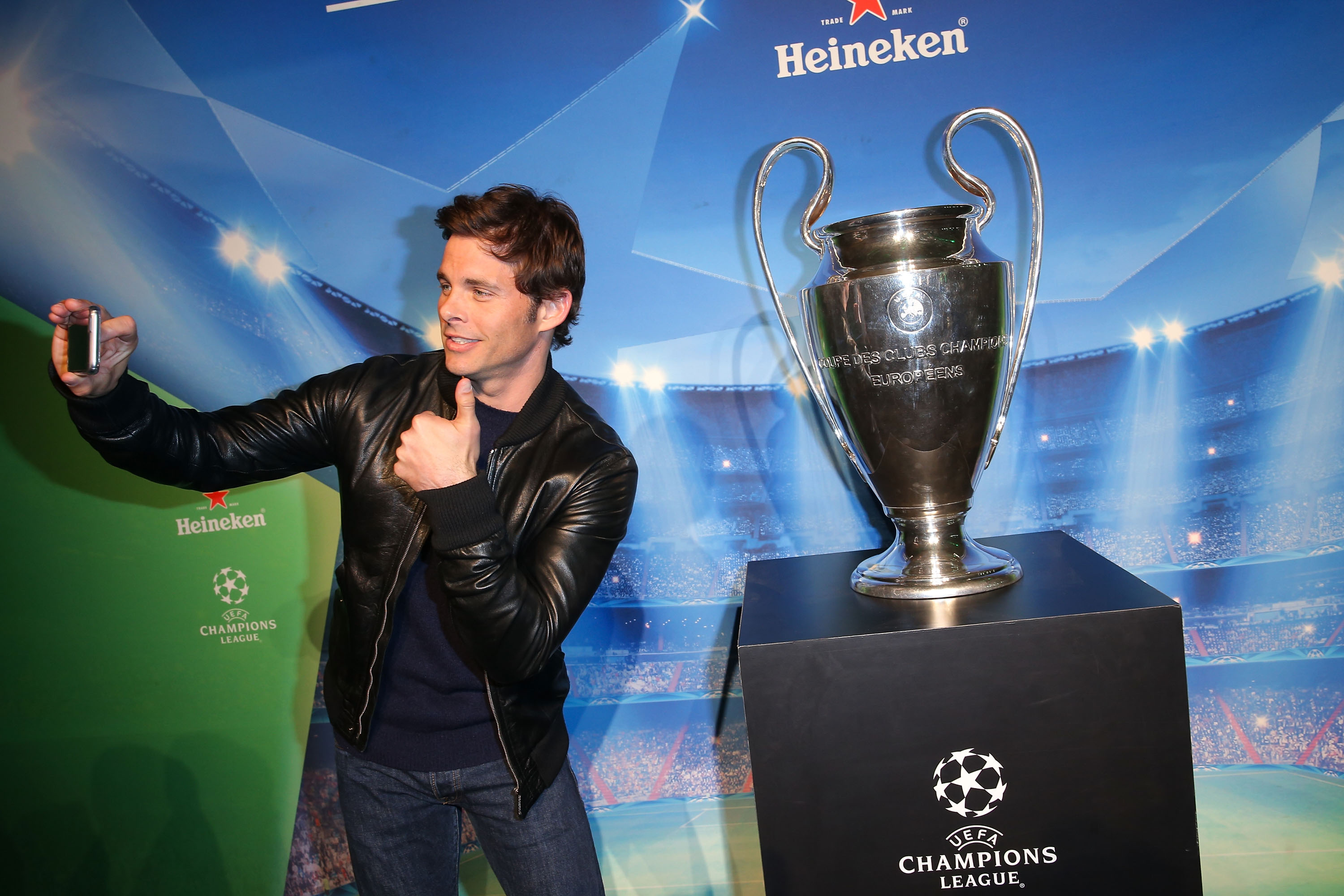 LOS ANGELES, CA - APRIL 20:  Actor James Marsden takes a selfie with the UEFA Championship trophy at The UEFA Champions League Trophy Tour presented by Heineken on April 20, 2015 in Los Angeles, California.  (Photo by Imeh Akpanudosen/Getty Images for Heineken)