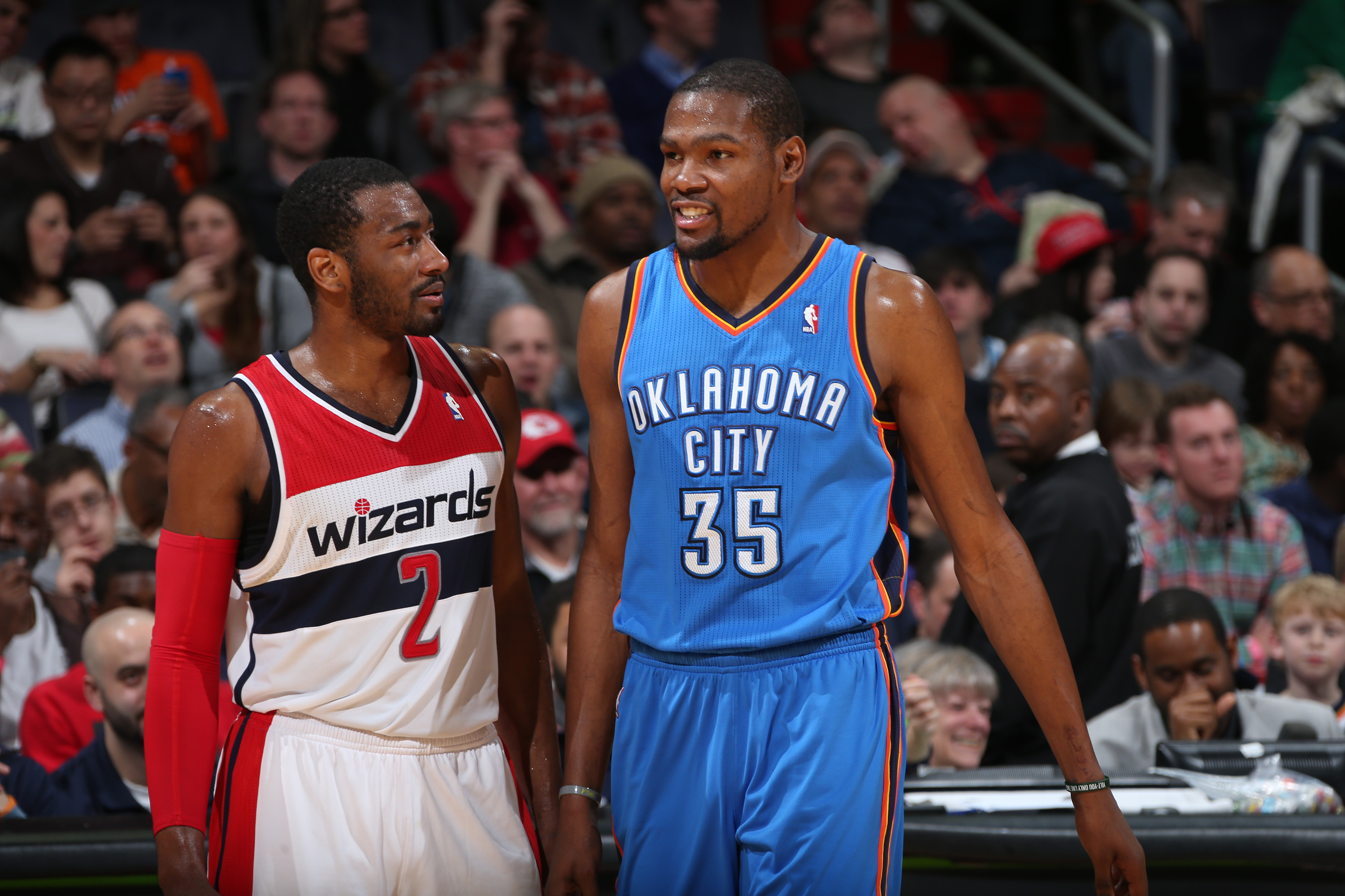 WASHINGTON, DC - FEBRUARY 2: John Wall #2 of the Washington Wizards talks with Kevin Durant #35 of the Oklahoma City Thunder during the game at the Verizon Center on February 2, 2014 in Washington, DC. NOTE TO USER: User expressly acknowledges and agrees that, by downloading and or using this photograph, User is consenting to the terms and conditions of the Getty Images License Agreement. Mandatory Copyright Notice: Copyright 2014 NBAE (Photo by Ned Dishman/NBAE via Getty Images)