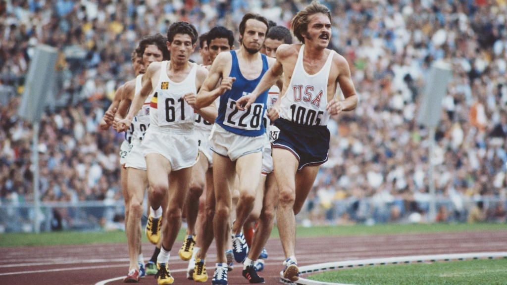 Steve Prefontaine #1005 of the United States leads Lasse Viren of Finland #228 and  Emiel Puttemans of Belgium #61  during the Men's 5,000 metres event at the XX Summer Olympic Games on 10 September 1972 at the Olympic Stadium in Munich, Germany.