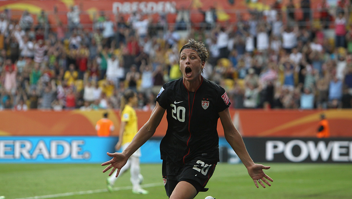 DRESDEN, GERMANY - JULY 10:  Abby Wambach of USA celebrates after scoring her team's equalizing goal during the FIFA Women's World Cup 2011 Quarter Final match between Brazil and USA at Rudolf-Harbig-Stadion on July 10, 2011 in Dresden, Germany.  (Photo by Martin Rose/Getty Images)