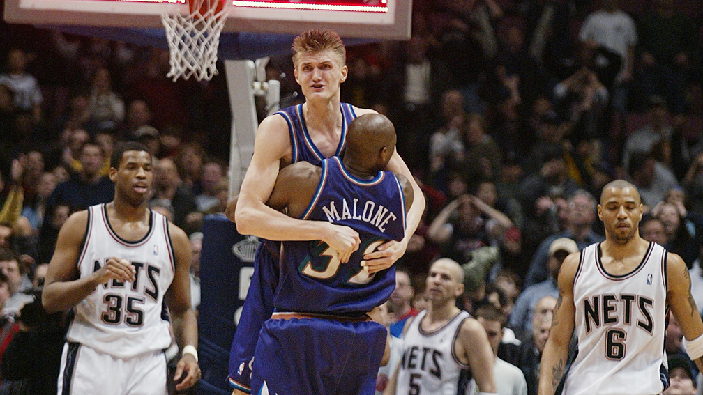 Utah's Andrei Kirilenko jumps into the arms of teammate Karl