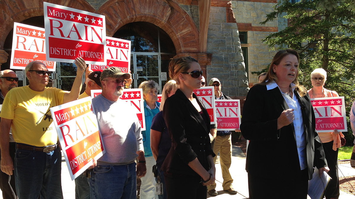 Mary Rain campaigns for St. Lawrence County DA in 2013, with Tandy Cyrus by her side.