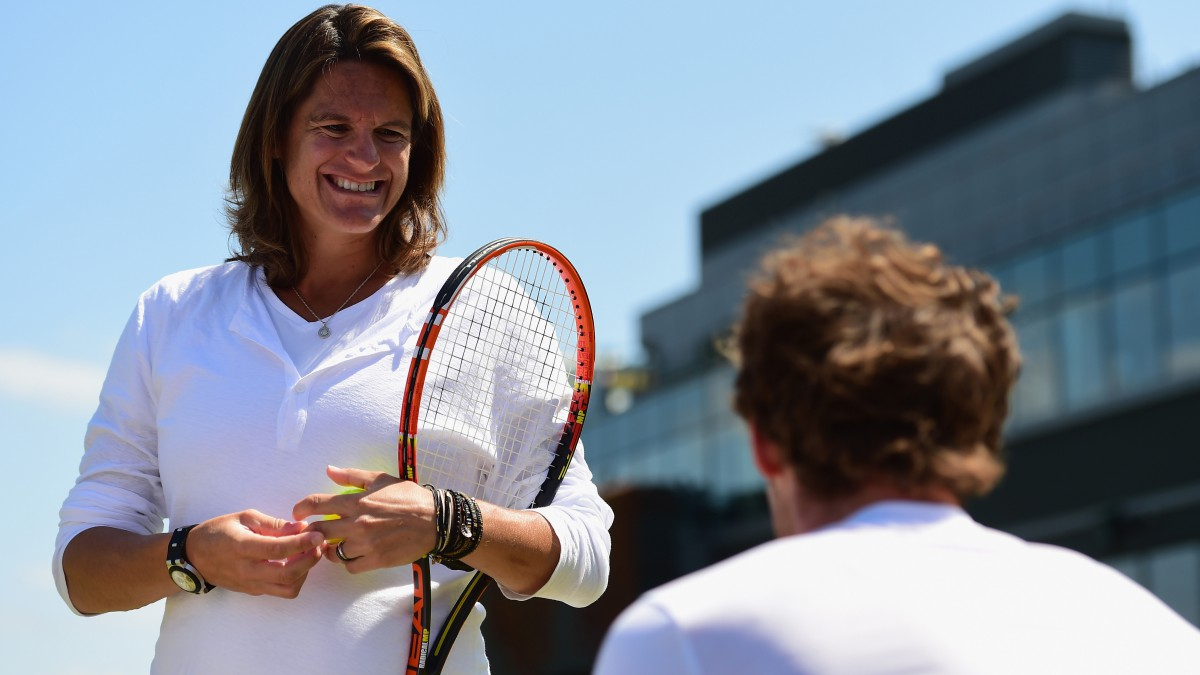 Amelie Mauresmo talks to Andy Murray during practice.