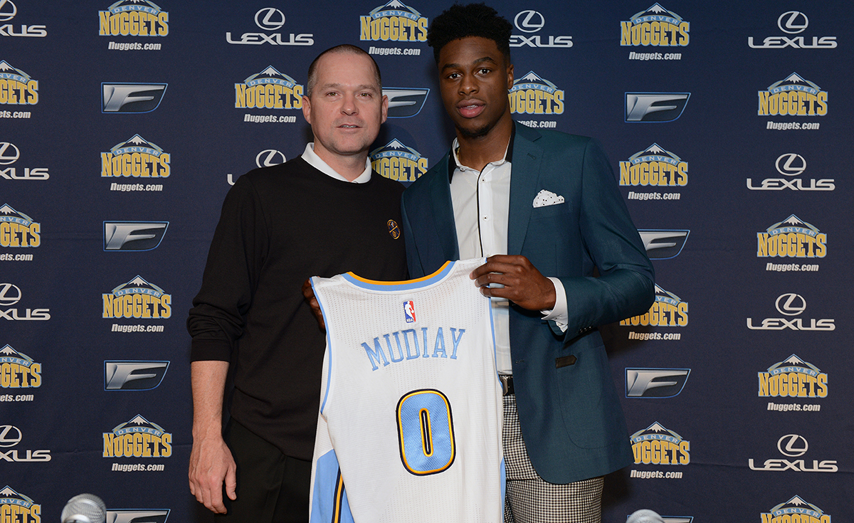 Malone with Emmanuel Mudiay.
