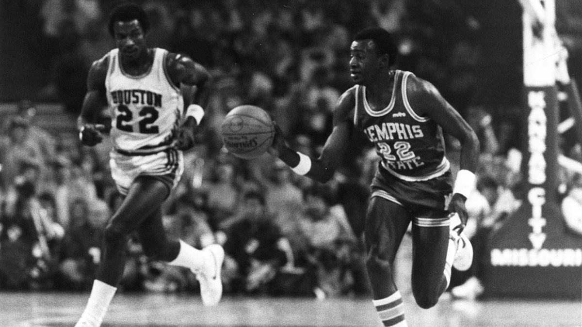 Bobby Parks pushes the ball up court with Clyde Drexler close behind in the 1983 Sweet Sixteen.