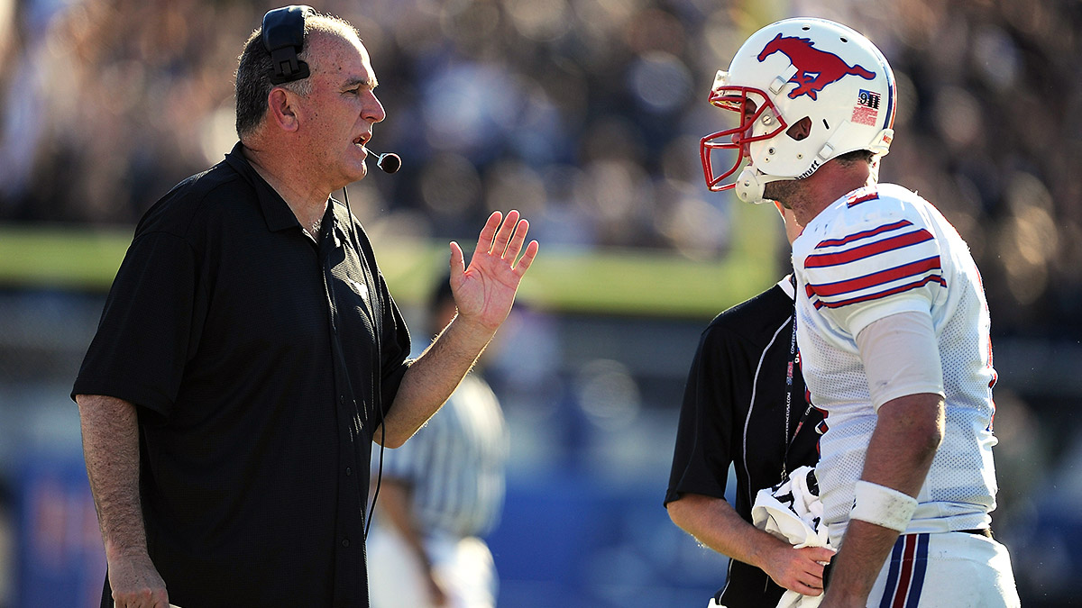 June Jones took SMU to four consecutive bowl games from 2009-2012, but resigned two games into the 2014 season amid the program's renewed struggles. (Rick Dole/Getty Images)