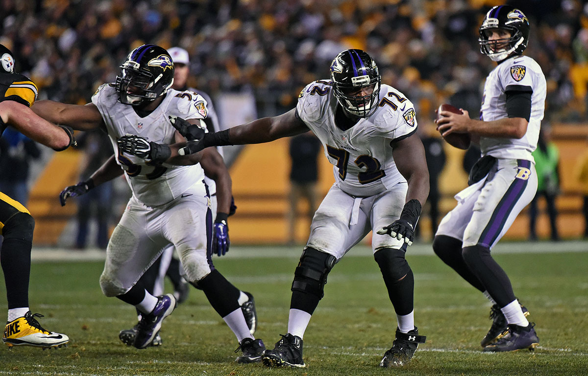 Kelechi Osemele (#72) protects Joe Flacco during a game against the Pittsburgh Steelers on November 2, 2014.