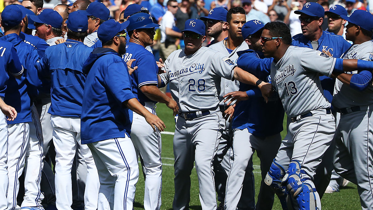 The Royals and Blue Jays brawled on the field on Sunday, then continued snipping at each other in postgame interviews. (Tom Szczerbowski/Getty Images)