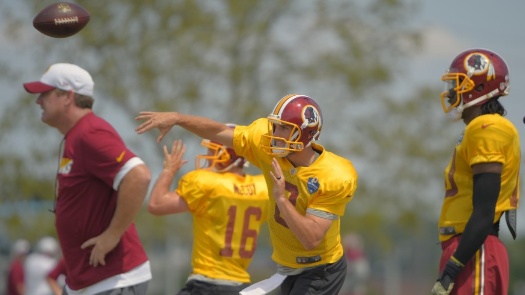 Washington head coach Jay Gruden watches passing drills with Colt McCoy (16), Kirk Cousins (8),, and Robert Griffin III (10) during training camp.