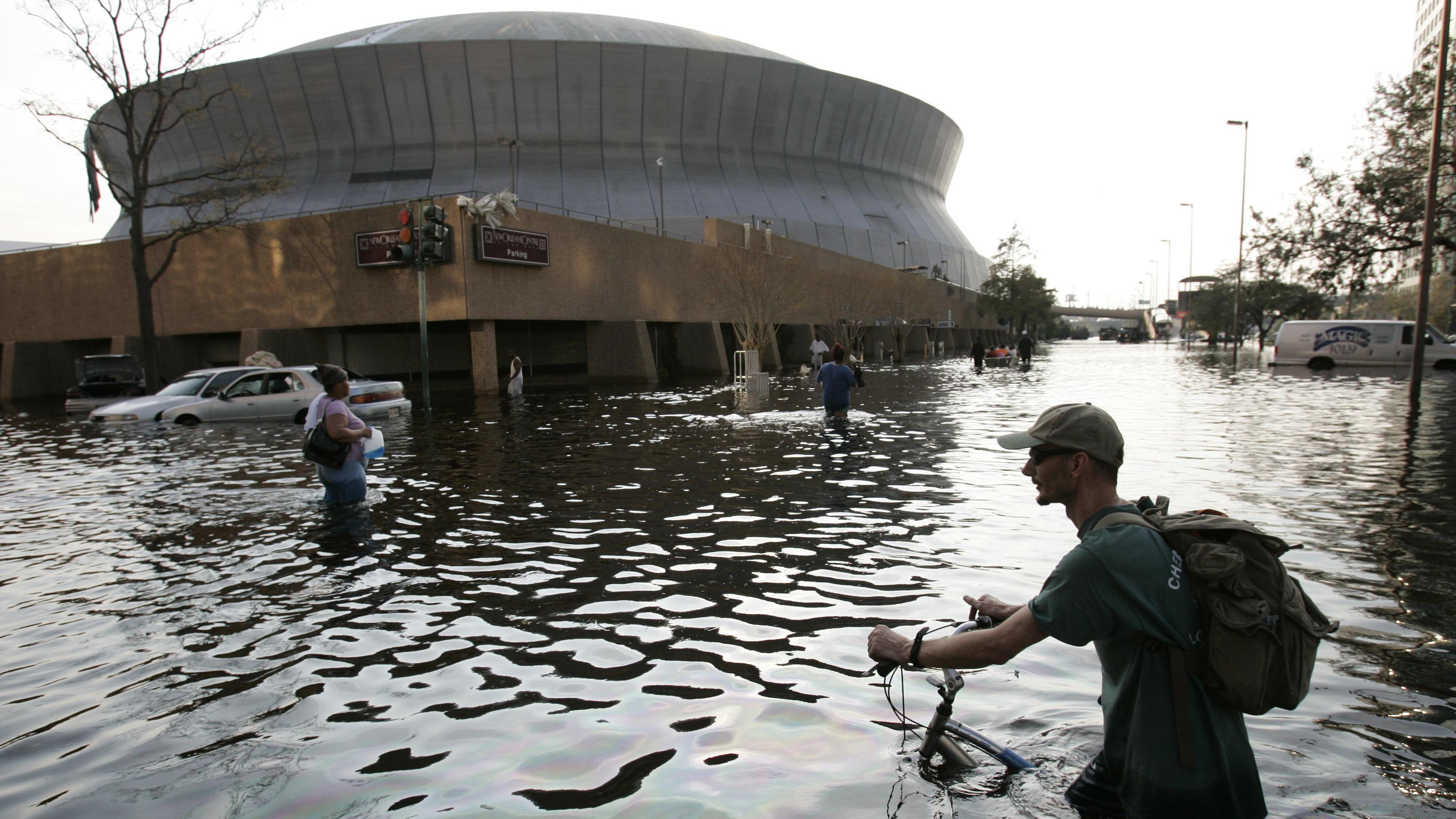 Aug. 31, 2005, a man pushes his bicycle through flood waters near the Superdome in New Orleans.