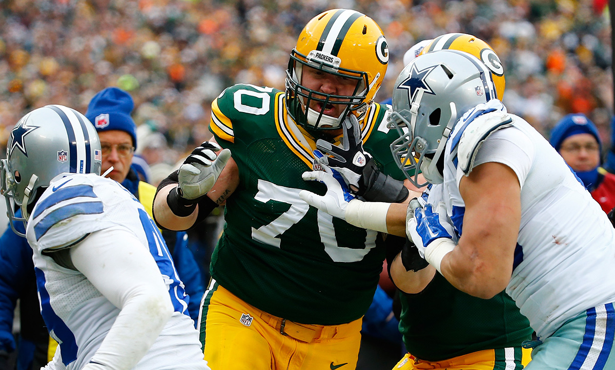 T.J. Lang confronts the Cowboys' Tyrone Crawford during the 2015 NFC Divisional Playoff game at Lambeau Field on January 11, 2015.