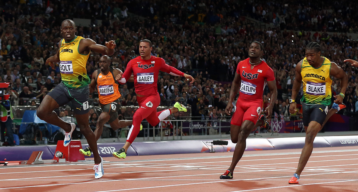 Bolt crosses the finish line to win gold in the Men's 100m Final in London at the 2012 Olympic Games.