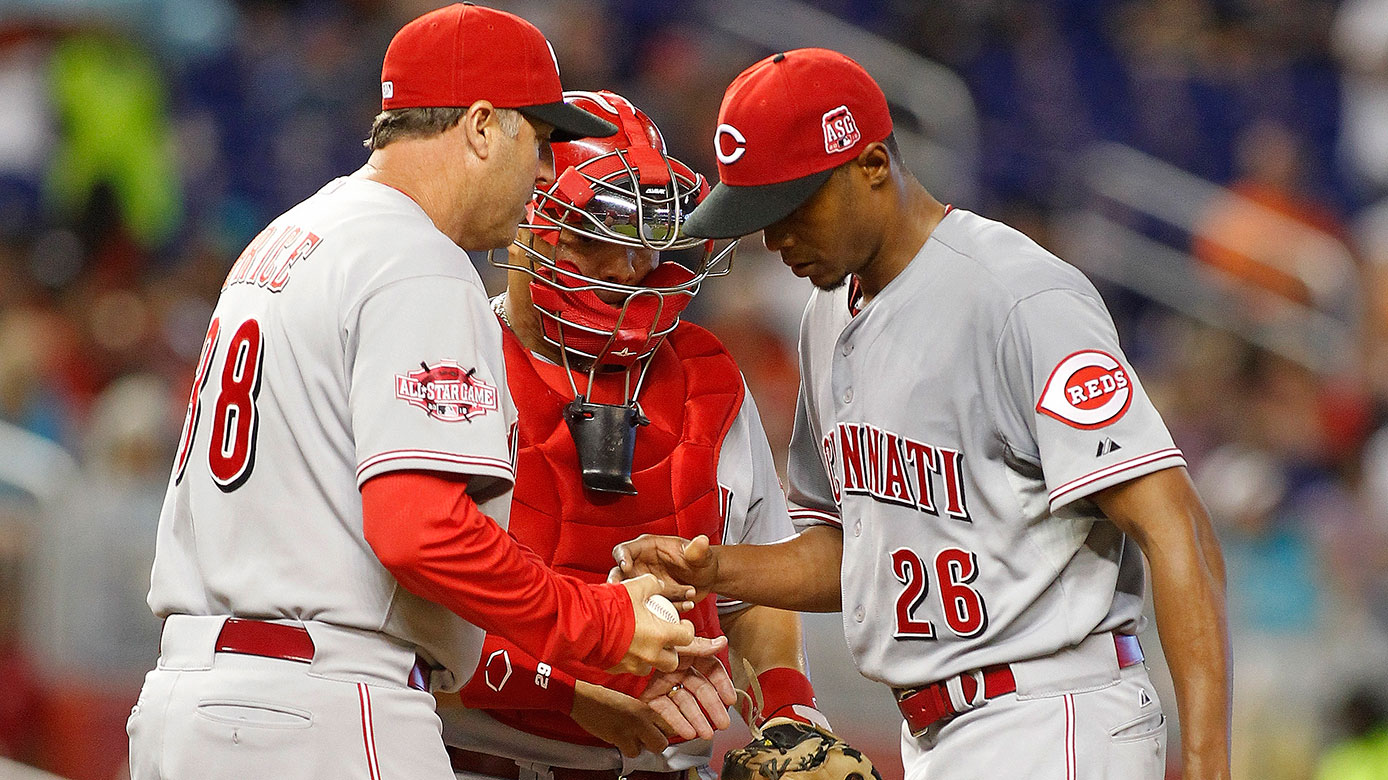 Raisel Iglesias gives the ball to manager Bryan Price.