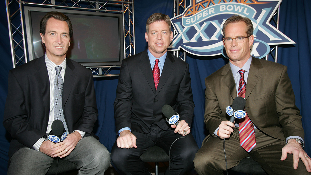 Collinsworth, Troy Aikman, and Joe Buck at FOX's Super Bowl XXXIX pregame show in 2005.