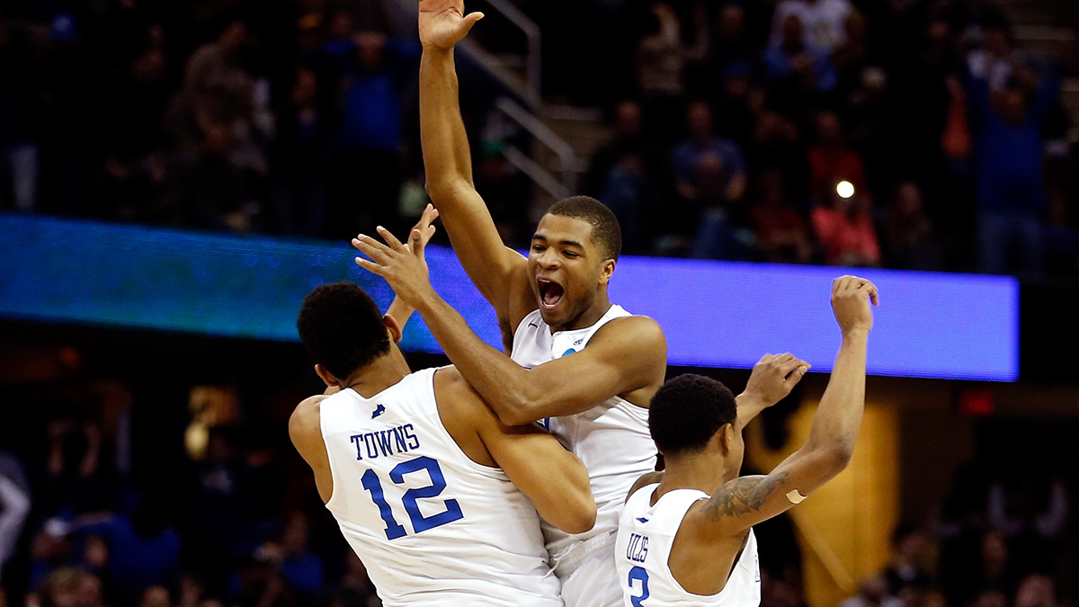 Aaron Harrison, Karl-Anthony Towns, and Tyler Ulis celebrating after defeating Notre Dame in the 2015 Elite Eight and extending Kentucky's record to 38-0. It was their last win of the season.