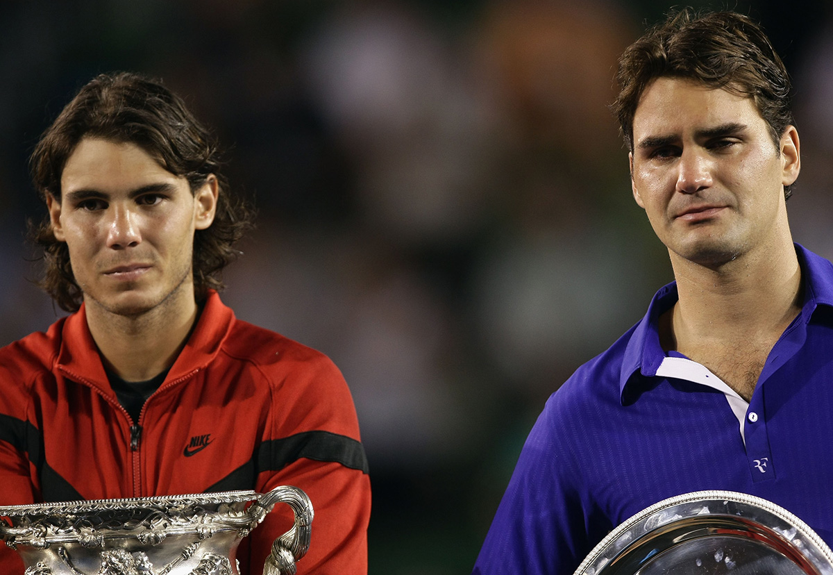 Nadal and Federer pose with their trophies after the men's final match of the 2009 Australian Open.